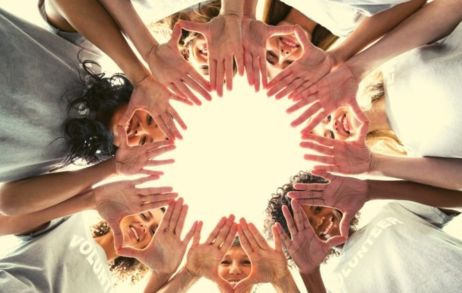 Women's faces and hands in a circle